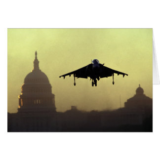 A Harrier jet landing on the Mall at dawn with Card