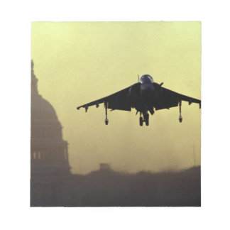 A Harrier jet landing on the Mall at dawn with Memo Notepads