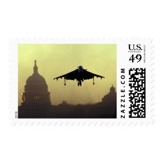 A Harrier jet landing on the Mall at dawn with Postage Stamp