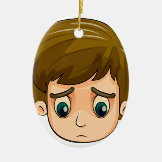 A head of a sad young boy Double-Sided oval ceramic christmas ornament
