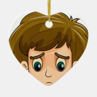 A head of a sad young boy Double-Sided heart ceramic christmas ornament