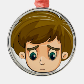 A head of a sad young boy round metal christmas ornament