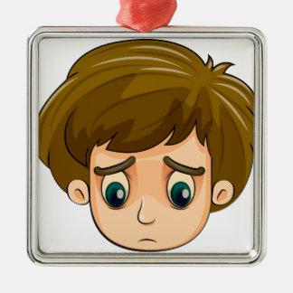 A head of a sad young boy square metal christmas ornament