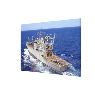 A helicopter clears the flight deck gallery wrap canvas