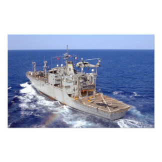 A helicopter clears the flight deck photo print