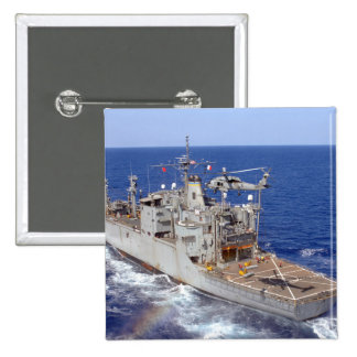 A helicopter clears the flight deck pinback button