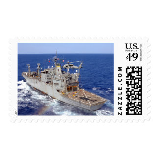A helicopter clears the flight deck postage stamp