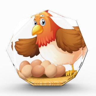 A hen and her seven eggs acrylic award