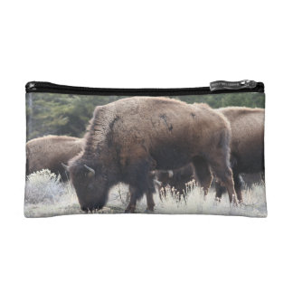 A Herd of Brown Bison Graze in a grassy Meadow Cosmetic Bag