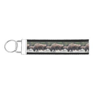 A Herd of Brown Bison Graze in a grassy Meadow Wrist Keychain