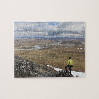 A hiker looks over the Nigu and Etivlik Rivers Jigsaw Puzzles