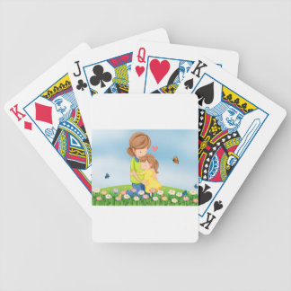A hilltop with a mother comforting her child bicycle playing cards