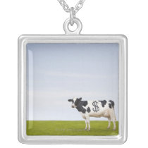 A Holstein Dairy cow with spots in the shape of Silver Plated Necklace