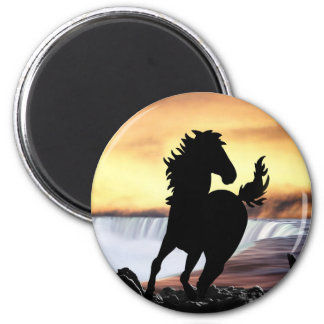 A horse silhouette and waterfall refrigerator magnet