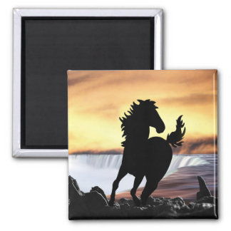 A horse silhouette and waterfall magnet