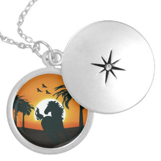 A horse silhouette at sunset round locket necklace