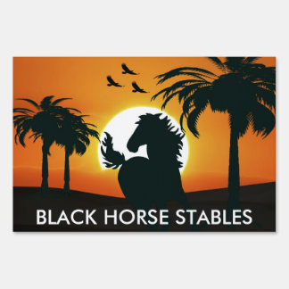 A horse silhouette at sunset signs