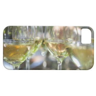 A host pours glasses of torrontes for guests at iPhone SE/5/5s case