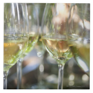 A host pours glasses of torrontes for guests at tile