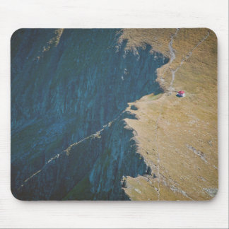 A house on a land with no life around it mouse pad