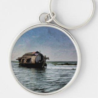 A houseboat moving placidly through coastal lagoon Silver-Colored round keychain