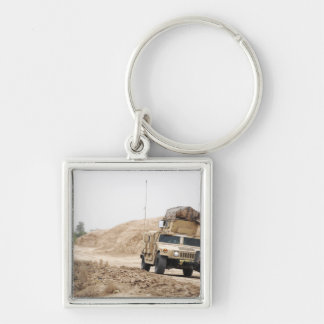 A Humvee conducts security Keychain