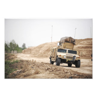 A Humvee conducts security Photographic Print