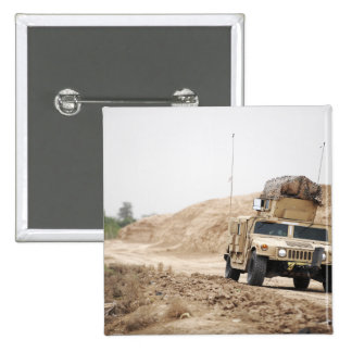 A Humvee conducts security Pinback Button