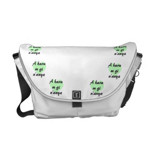 A huru m gi n'anya - Igbo I love you Green Hearts. Courier Bag