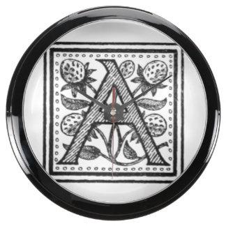 A Initial from A Monk of Fife Aqua Clocks