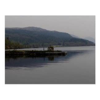 A jetty pushing out into the waters of Loch Ness Postcard