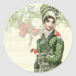 """A Joyous Noel Classic Round Sticker<br><div class=""""desc"""">A beautiful vintage Regency fashion plate teamed with adorable vintage images of robins takes centre stage in this festive shabby chic romantic Jane Austen inspired collage.  © Wickedly Lovely</div>"""