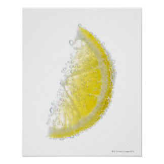 A juicy ripe organic lemon wedge fruit submerged poster