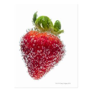 A juicy ripe organic Strawberry fruit submerged Postcard