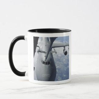 A KC-10 Extender prepares to refuel a C-5 Galax Mug