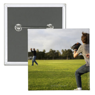 A kid wearing a baseball glove waits for his dad 2 inch square button