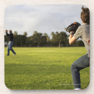 A kid wearing a baseball glove waits for his dad coaster