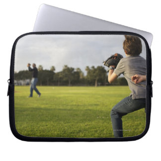 A kid wearing a baseball glove waits for his dad laptop computer sleeve