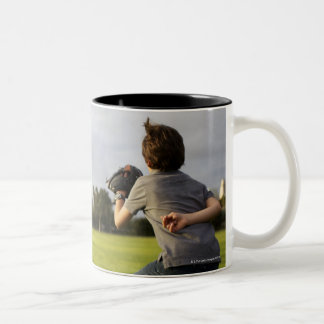 A kid wearing a baseball glove waits for his dad Two-Tone coffee mug