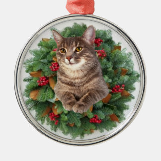 A kitten and a Christmas wreath Round Metal Christmas Ornament