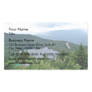 A lake in the middle of a forest business card