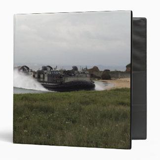 A landing craft air cushion comes ashore binder