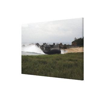 A landing craft air cushion comes ashore canvas print