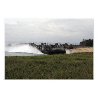 A landing craft air cushion comes ashore photo