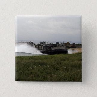 A landing craft air cushion comes ashore pinback button