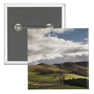 A Landscape With Rolling Hills And Clouds Overhead 2 Inch Square Button