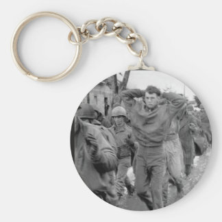 A lanky GI, with hands clasped behind_War Image Keychain