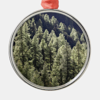 A larch forest in autumn metal ornament