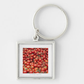 A large crop of tomato on a market stall in keychains