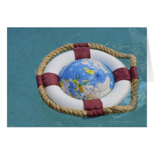 A life preserver and world globe floating card